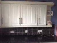 White complete kitchen with intergrated fridge cooker, and hob