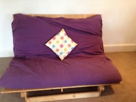 IKEA futon-pine base with purple cover.Used but in good condition