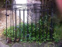 Black painted old style heavy iron gates