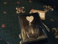 Glass perfume bottle with heart shaped stopper in box