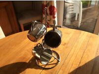 Stainless steel mugs and stand