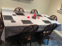 Second hand dark wood extendable dining table ( Jacyee Furniture Limited) and 6 chairs