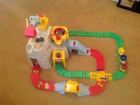 Railroad boulder set. Rail track with carts and engine. Mountain range with boulders and crane.