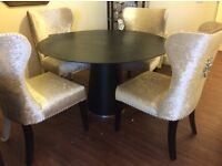Dark chocolaty coloured circular dining table in fab condition for sale. Not chairs.