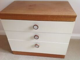 Wooden chest with white draws
