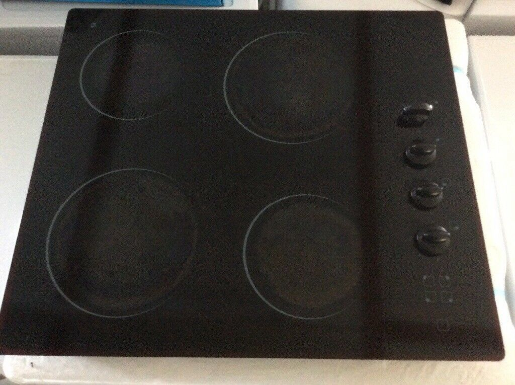All black ceramic hob. 3 rings working. Only £40