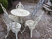 Cast iron table 4 chairs regal design