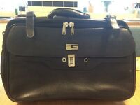 Nice leather overnight bag expendable with wheels