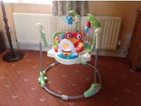 Used Fisher Price rainforest jumperoo in good condition