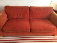 Harvey's 3 seater sofa in terracotta, some fading to the arms otherwise good condition.