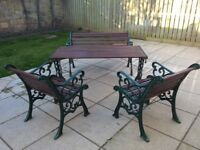 Wrought Iron and Wood garden furniture. One bench two chairs and a table. Very good condition.