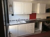 Kitchen with sink and electric hob.