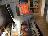 2 trendy grey metal dining chairs