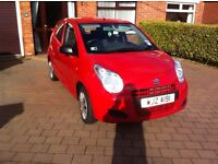 For sale: 2014 Red Suzuki Alto sz 996 CC petrol. 5 door hatchback 1 owner