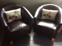 2 Brown Leather Tub Chairs. Used but still in good condition.