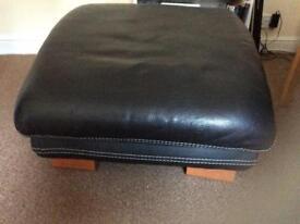 Large black leather foot stool
