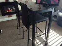 Kitchen breakfast bar and two high chairs