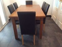 Light wood dining table and 6 chairs