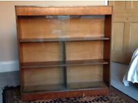 Bookcase / display cabinet with sliding glass doors
