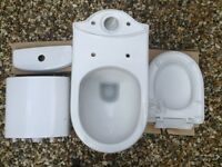 WHITE CLOSE-COUPLED LOW FLUSH TOILET