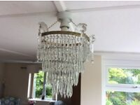Glass chandelier with 4 tiered rings of individual glass droplets. Age unknown but not modern.