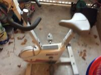 Exercise bike with distance and pulse rate monitor