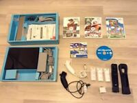 black wii with games and accessories