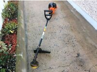 Tanaka AST -700 long reach petrol grass strimmer. Auto start. Solid steel shaft. Manual included.