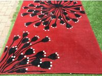 Red black and white large rug