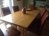 Solid wood table 6 leather tan chairs