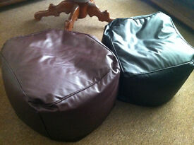 Two faux-leather puff chairs for sale. Brown and black.