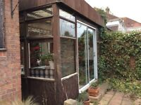 Used wooden conservatory make good greenhouse