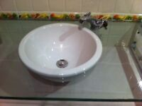 White Ceramic Circular Sink 388 mm diameter. Sunk in clear glass