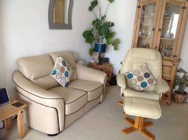 Cream 2 seater settee leather + swivel reclining cream armchair & footstool.