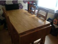 Solid pine extendable dining table with 6 chairs