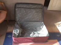 Large expandable burgundy suitcase. 81x30x53 cm. Two spacious front pockets. Never been used.