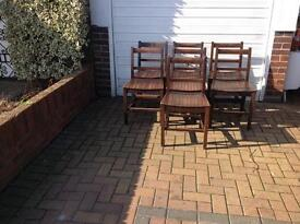 7 oak chairs with slatted seats
