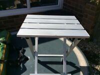 Foldable white rigid camping/garden stool