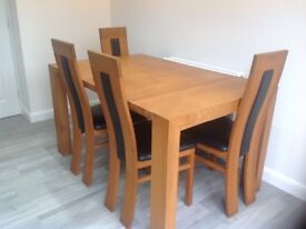 Solid oak extendable dining table and 4 chairs for sale