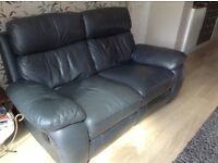 2 seater reclining leather sofa. Bluey grey colours, small damage on the front cushion.