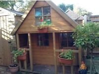 Large wooden two storey playhouse
