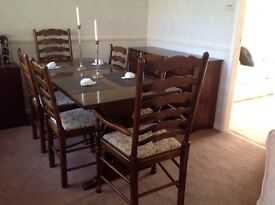 Oak dining table with six chairs