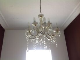 Lovely gold/crystal effect chandelier.