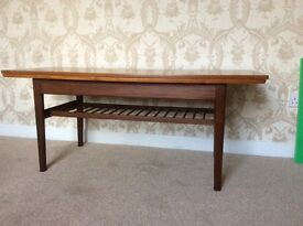 Danish metamorphic table . Coffee table changes to dining table