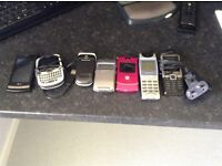 Box of my old contract phones and Bluetooth headsets