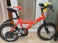 Raleigh boys bike 14 in with hot wheels helmet