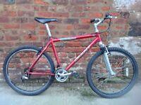 Giant men's hardtail mountain bike ready to ride away