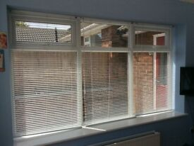 9 White aluminium venetian blinds. Individually priced.