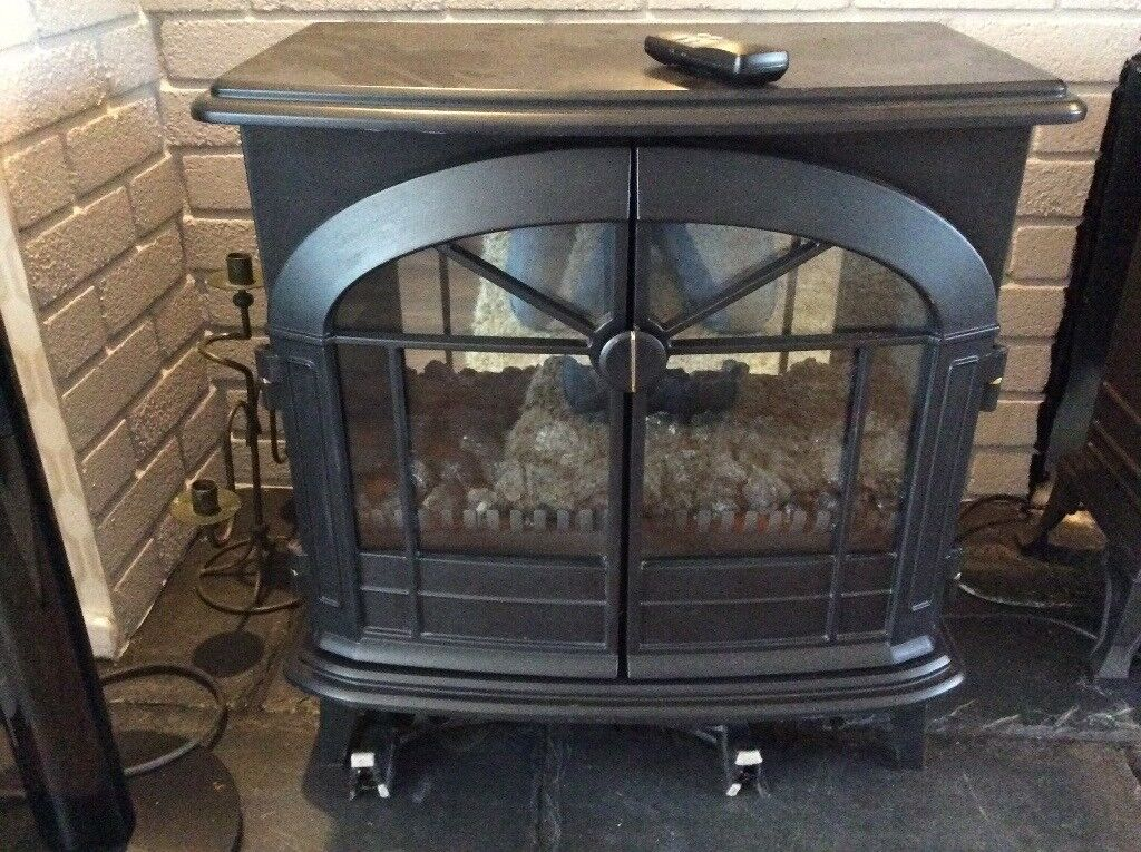 Black stove type Dimplex (electric fire 2KW), excellent, looks like wood burner.