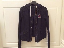 Hollister ladies navy hooded light jacket size medium with front logo in excellent condition